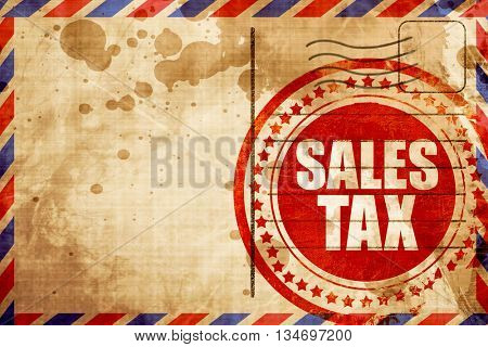 sales tax, red grunge stamp on an airmail background