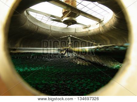Fan and rotating water fall Inside Cooling Tower