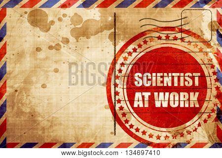 scientist at work, red grunge stamp on an airmail background