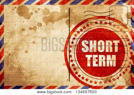 short term, red grunge stamp on an airmail background