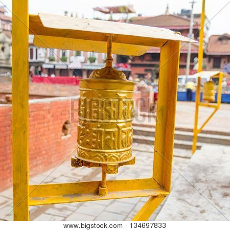 Yellow coloured Prayer Wheels placed at the Patan Durbar Square in KathmanduNepal.