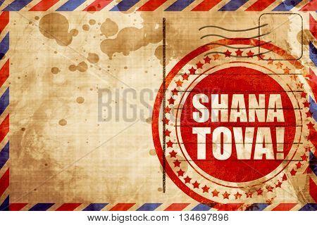 shana tova, red grunge stamp on an airmail background