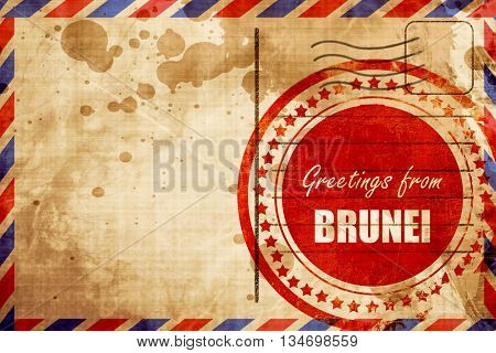 Greetings from brunei, red grunge stamp on an airmail background