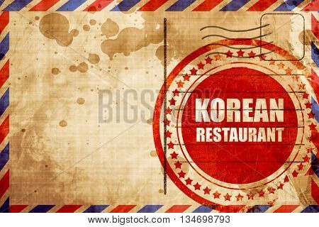 Delicious korean cuisine, red grunge stamp on an airmail backgro