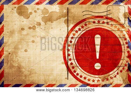 Hazard warning sign, red grunge stamp on an airmail background
