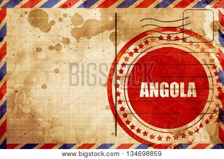 Angola, red grunge stamp on an airmail background