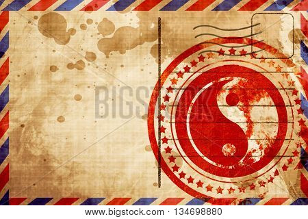 Ying yang symbol, red grunge stamp on an airmail background