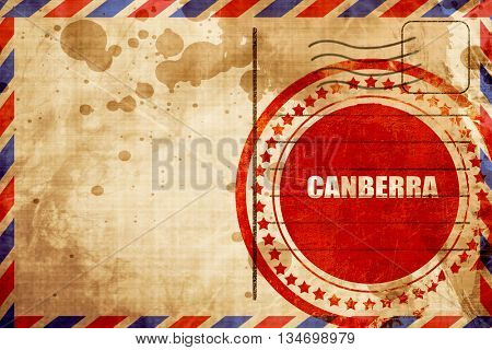 canberra, red grunge stamp on an airmail background