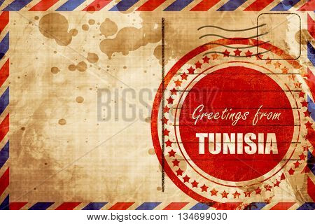 Greetings from tunisia, red grunge stamp on an airmail backgroun