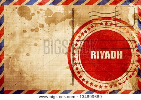 riyadh, red grunge stamp on an airmail background