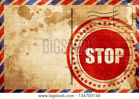 stop, red grunge stamp on an airmail background