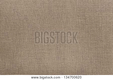 surface of rough fabric or textile material for the textured wallpaper and for a background of monochrome sepia color