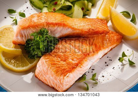 Grilled salmon steaks and vegetables