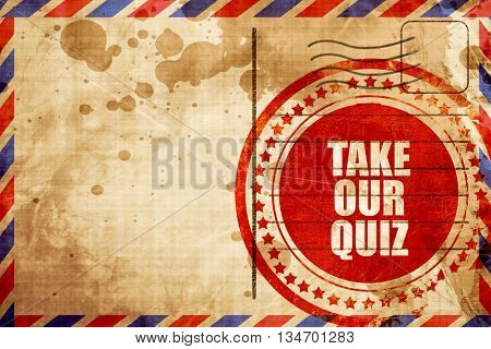 take our quiz, red grunge stamp on an airmail background