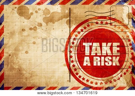 take a risk, red grunge stamp on an airmail background
