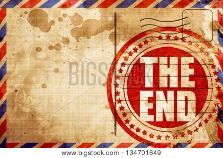 the end, red grunge stamp on an airmail background