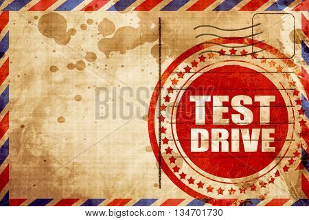 test drive, red grunge stamp on an airmail background