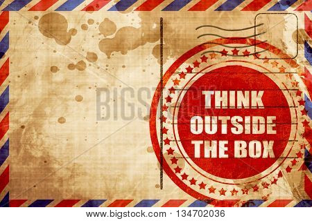 think outside the box, red grunge stamp on an airmail background