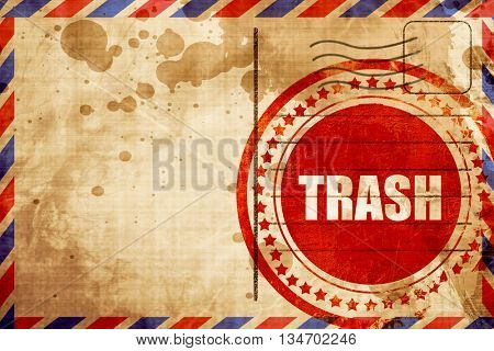 trash, red grunge stamp on an airmail background