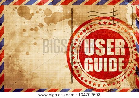 user guide, red grunge stamp on an airmail background