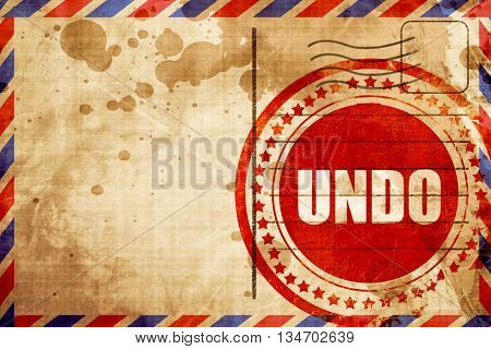 undo, red grunge stamp on an airmail background