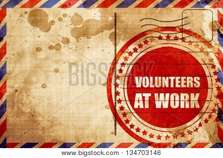 volunteer at work, red grunge stamp on an airmail background