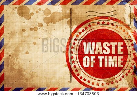 waste of time, red grunge stamp on an airmail background