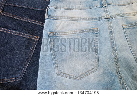 Closeup at back side of jean trousers background