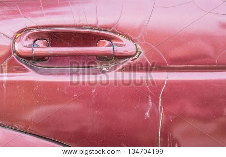 Closeup surface handle of old red car texture background