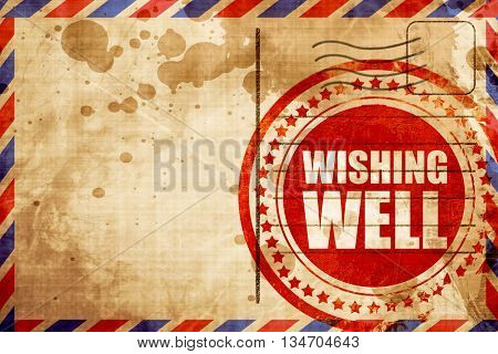 wishing well, red grunge stamp on an airmail background