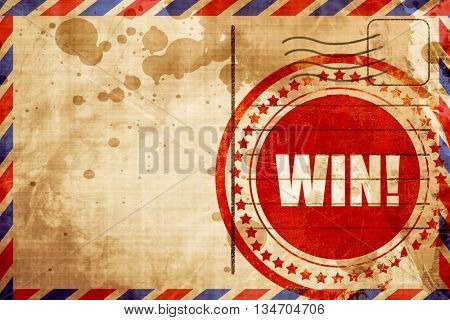 win!, red grunge stamp on an airmail background