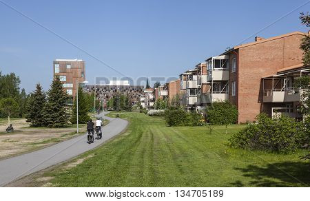 UMEA, SWEDEN ON JUNE 02. View of a modern urban living close to the center on June 02, 2016 in Umea, Sweden. Apartments, Academy of Fine Arts, park, walkway and sunshine. Editorial use.