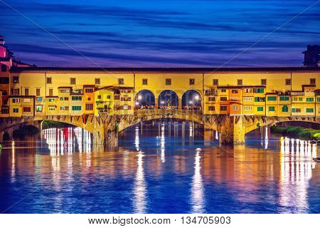 Late sunset at bridge ponte vecchio in florence old town on arno river italy
