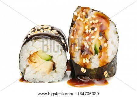 Maki sushi, two rolls isolated on white. Nori, rice, smoked eel, sesame seeds, teryaki sauce