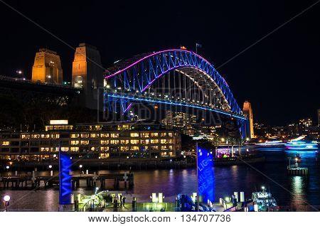 Sydney Australia - May 27 2016: Sydney Harbour Bridge illumination during Vivid Sydney festival 2016. Colourful iconic landmark night background