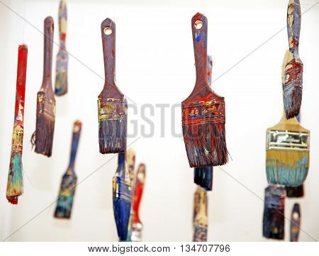 Art objects painty brushes hanging in the air. Shallow depth of fields