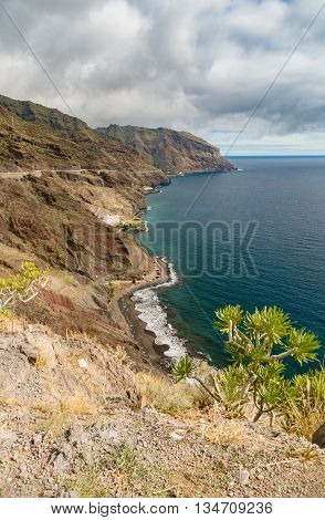 View on wild secluded beach Las Gaviotas and South-East coast of Tenerife Canary islands Spain