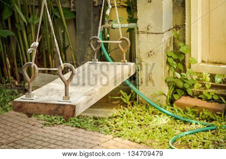 Selective focus with place your text, Hanging swing wooden