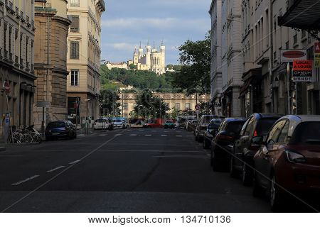 LYON, FRANCE - MAY 17. 2016: This is a view of the Basilica of Notre-Dame de Fourviere on a hill towering over Lyon in the early morning.