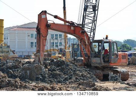 SELANGOR, MALAYSIA -JANUARY 02, 2016: Excavators machine is heavy construction machine used to do soil excavation work at the construction. Powered by long hydraulic arm with basket. Handle by workers.