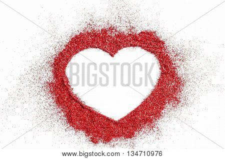 Red Glitter heart shape on white background with copyspace ready for your text or message.
