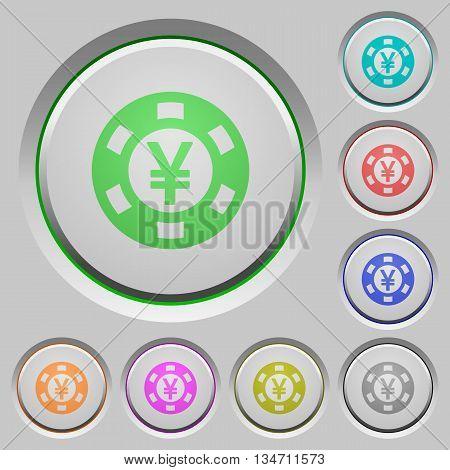 Set of color Yen casino chip sunk push buttons.