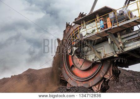 Giant bucket wheel excavator with cloudy sky