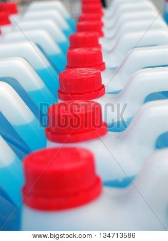 The canisters with a liquid detergent for the car cleansing