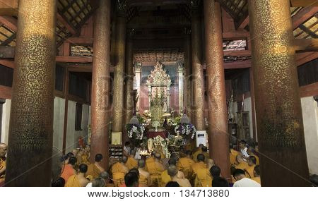 Monk And People Pray To Buddha Relic In Buddhist Temple