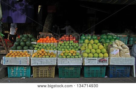 Hue, Vietnam - May 27, 2015: stand with fruits on street market in Hue Vietnam