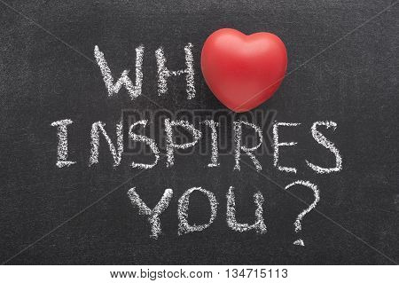 who inspires you question handwritten on blackboard with heart symbol instead of O