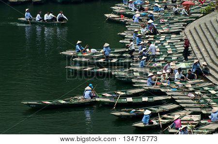 Ninh Binh, Vietnam, April 21, 2016 Boating, Trang An, Ninh Binh, ecotourism destinations, world natural heritage recognized, many tourists boating, sightseeing