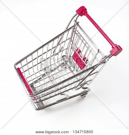 Close up of a shopping cart on a white background