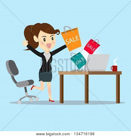 Business women shopping online with website on computer.